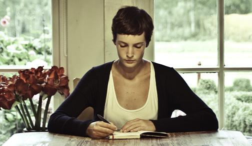 Woman writing in notebook Lesbian webcam girls